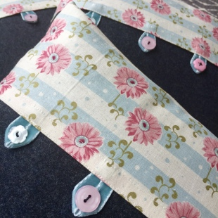 Cushion Handsewn with recycled buttons