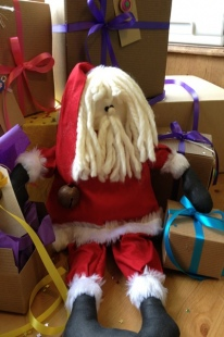 Santa Red and recycled gift boxes and ribbon
