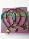 Friendship bracelets on recycled gift box