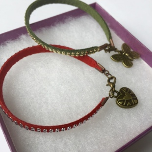 Friendship bracelets in recycled gift box
